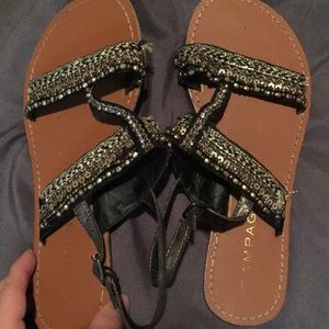 Black and gold flat sandals